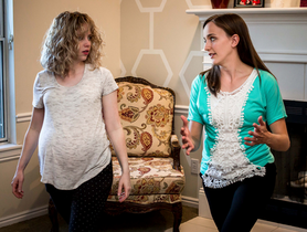 Pregnant woman and doula lunging during birth preparation visit